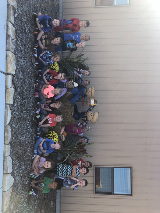 Both Kindergarten classes had a little Fall Fun today making scarecrows for the front of the building.